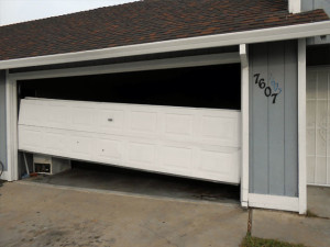 Garage-Door-Repair-Before-A1-Outside-Broken